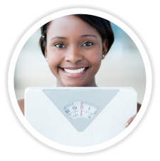 girl holding a weight scale